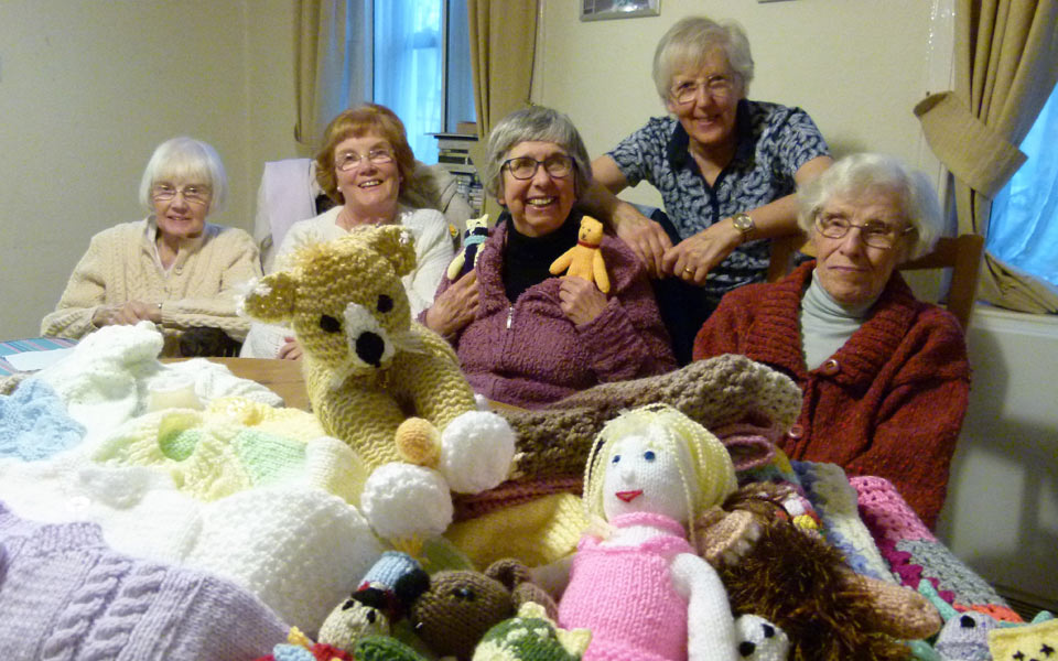 Residents at the Dulwich Almshouse knitting for premature babies